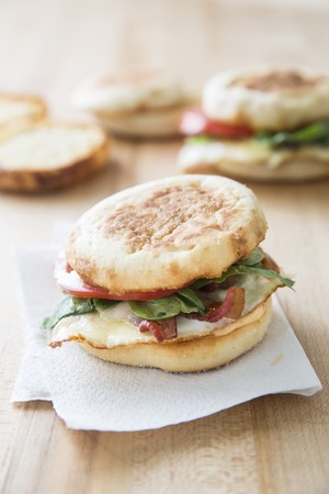 English muffins with bacon, eggs and cheese for breakfast