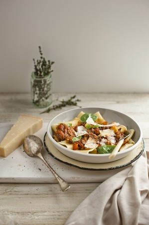 Pasta with beef ragout, Parmesan cheese and basil LANG_EVOIMAGES
