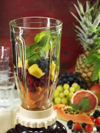 Ingredients for a fruity smoothie in a blender LANG_EVOIMAGES