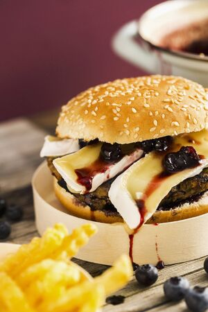 food: A veggie burger with a bean patty, Camembert and a blueberry and balsamic chutney