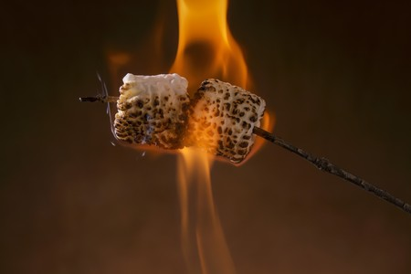 guy fawkes night: Marshmallows being toasted on a stick over a flame LANG_EVOIMAGES