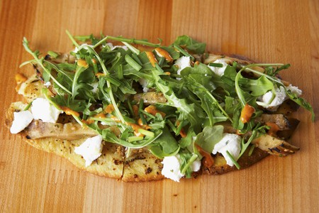 unleavened bread with goats cheese, aubergines and rocket