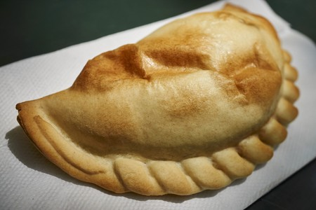 A baked Argentine style empanada sold by a Mahattan, NYC, street vendor