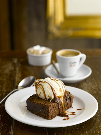 A brownie with vanilla ice cream and espresso in a pub LANG_EVOIMAGES