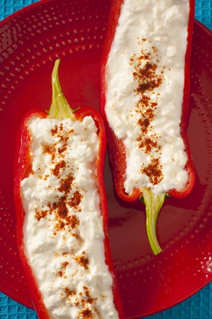Stuffed peppers with feta, sprinkled with ground paprika LANG_EVOIMAGES