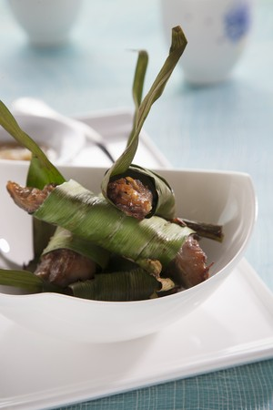 Grilled mackerel fillet in pandan leaves LANG_EVOIMAGES