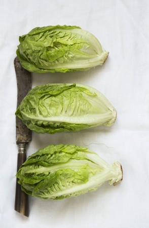 Three lettuces with an old knife