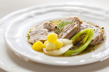 Boiled beef with potatoes, onions and leek