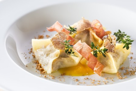hams: Meat-filled ravioli with pumpkin sauce, bacon and truffle