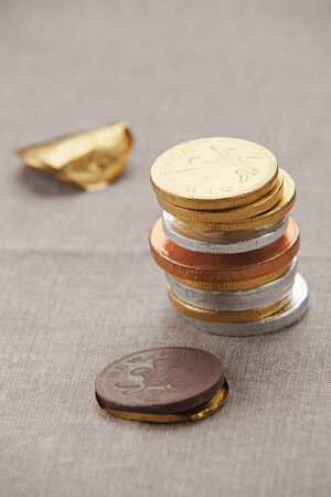 lucky charm: A stack of chocolate coins in foil on a tablecloth