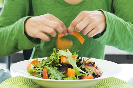 Salad leaves with carrots and tomatoes