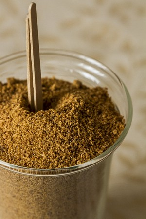 Coconut flower sugar in a glass with wooden sticks LANG_EVOIMAGES