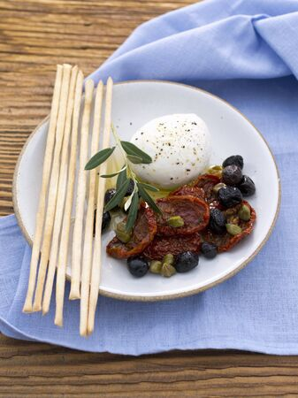 gressins: Buffallo mozzarella with grissini, capers, dried tomatoes and olives