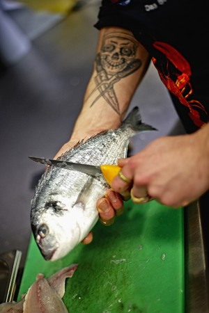 A seam bream being scaled