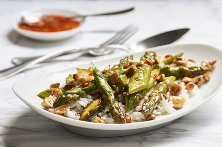 Fried green asparagus in sweet and spicy sauce with cashews on basmati and wild rice LANG_EVOIMAGES