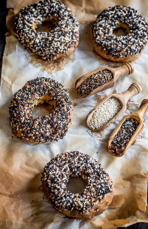 Freshly baked bagels with healthy seeds on the top LANG_EVOIMAGES