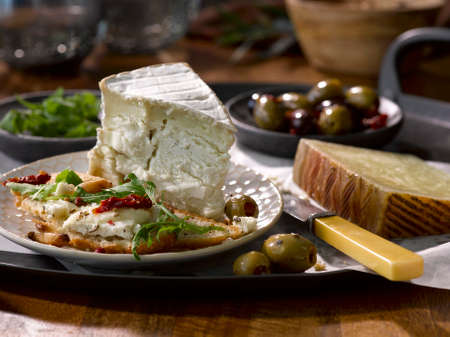 A cheese plate with olives