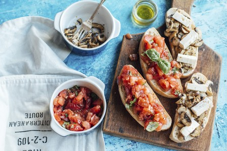 White chiabatta bread cut with toppings, tomato and mushrooms with brie cheese LANG_EVOIMAGES