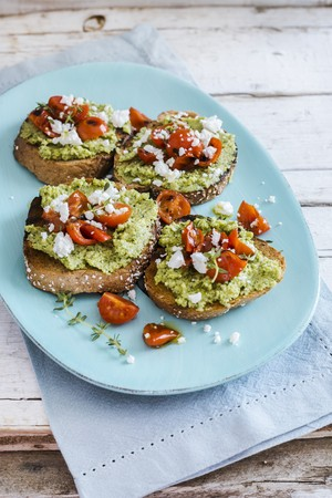Bruschetta with courgette pesto, roasted tomatoes, feta cheese and thyme