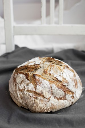 A loaf of homemade sourdough bread (wheat and rye flour with rye sourdough)