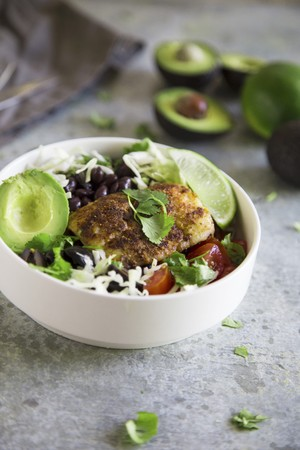 Taco Bowl with fish, avocado and black beans and white cabbage