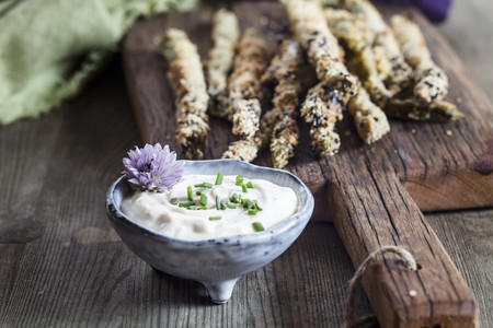 coatings: Fried breaded asparagus with almond flour and sesame seeds, and a herb dip