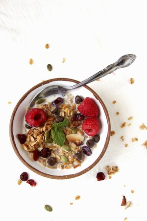 Muesli with raspberries, dried fruit and chocolate chips