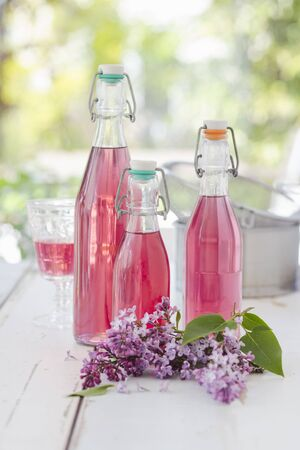 Bottles of lilac flower syrup LANG_EVOIMAGES
