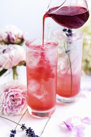 Gin tonic with blackberry syrup