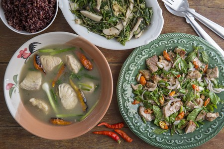 Lao Dishes Of Spicy Pork Salad Fish Soup And Fiddlehead Ferns - Cuisine laotienne