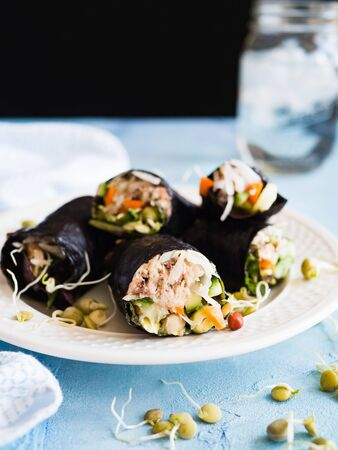 seaweeds: Nori wraps on a plate with shoots