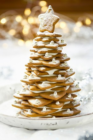 A gingerbread tree with icing sugar and silver beads for Christmas