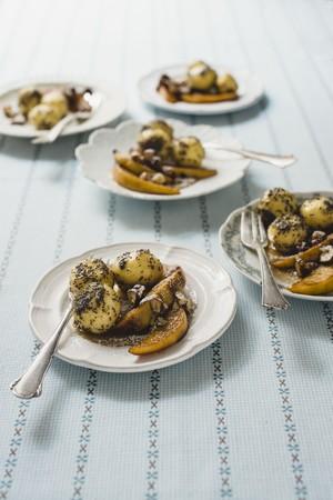 Poppy dumplings with glazed quinces