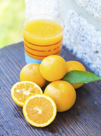 Orange juice squeezed from freshly picked amall Portuguese oranges LANG_EVOIMAGES