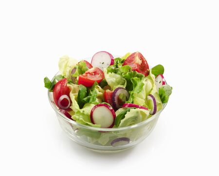 A mixed salad with garden lettuce, lambs lettuce, tomatoes and radishes