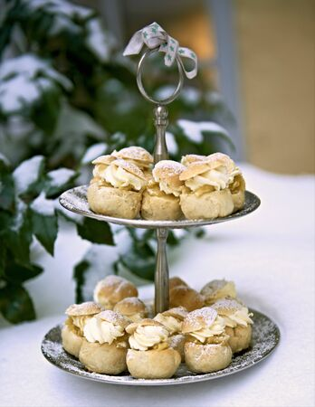 Small profiteroles on a cake stand LANG_EVOIMAGES
