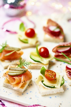 charcutería: Various canapes with smoked salmon, cheese and salami for Christmas