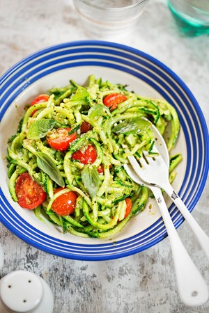 Spiralled courgette with cherry tomatoes and pesto