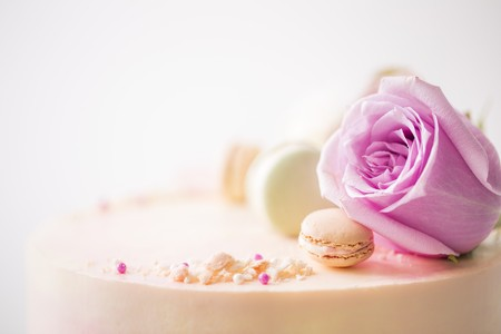 pinky: Pink marbled celebration cake decorated with flowers, macarons and petals