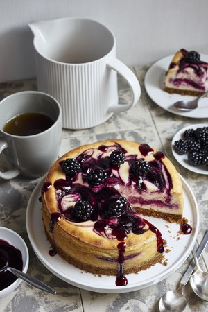 A small blackberry cheesecake, sliced