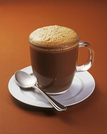 A cappuccino in a glass cup