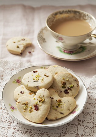 Cookies with pistachios and dried rose petals, served with a cup of coffee LANG_EVOIMAGES