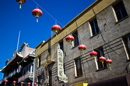 influx: SAN FRANCISCO, CA - CIRCA MARCH 2015 - Red Lanterns hang across a street in Chinatown, San Francisco USA, attesting to the great melting pot of America due to the influx of immigrants over the years.