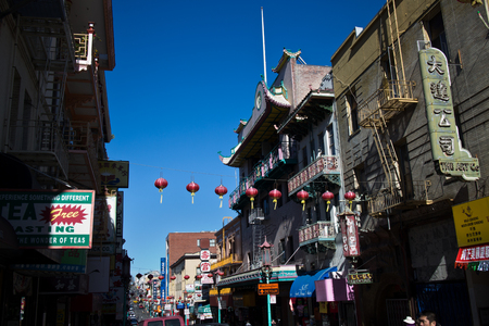 SAN FRANCISCO, CA - CIRCA MARCH 2015 - Wide shot of Red Lanterns hang across a historic street in Chinatown, San Francisco USA, attesting to the great melting pot of America due to the influx of immigrants over the years.