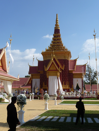pyre: Preparations are made for the cremation ceremony of the Cambodian monarch, the King Father Sihanouk, shortly after his passing.  The stupa-like structure in the background will contain the pyre, while guards look on. Stock Photo