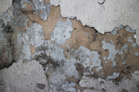 underlying: Medium close up of an old colonial wall in Asia with a variety of textures including chipped, broken and missing stucco, sandstone, black mold, and general weathering of the brown underlying surface.