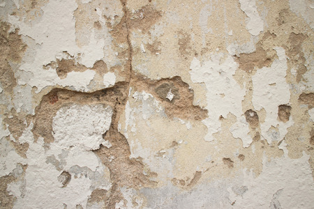 fissures: Detail of cracked colonial stucco wall in Asia, with fissures and hairline fractures running through at various levels.