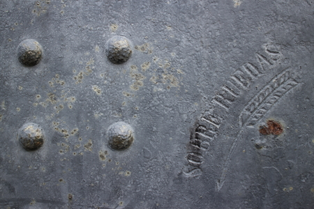 braille: Close up of rivets arranged in a square braille-like pattern on the side of an old canon along the coast of Northern California, USA.