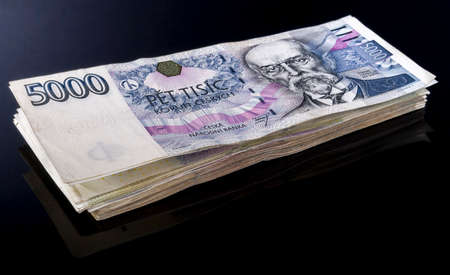 onehundred: czech money on black background