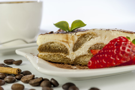 italian desert tiramisu with coffe and strawberry on white background photo